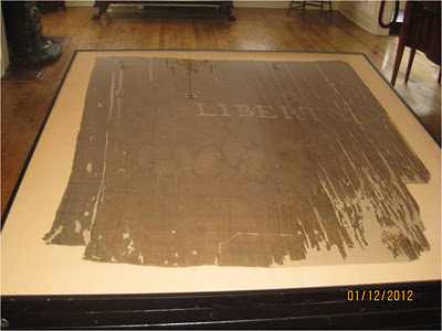 Liberty Flag in Schenectady New York, conserved, mounted and frames by historic flag expert Gwen Spicer of Spicer Art Conservation, pre Revolutionary war flag, sons of Liberty