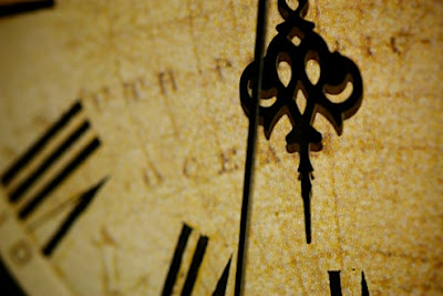 Hands of a rustic clock pictured with sharp focus
