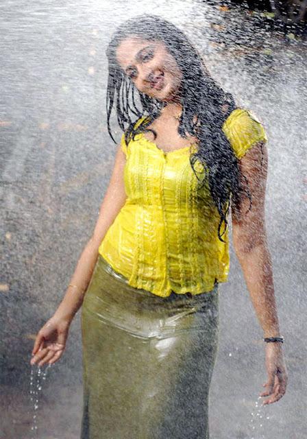 Anushka In Yellow Dress Wet Stills