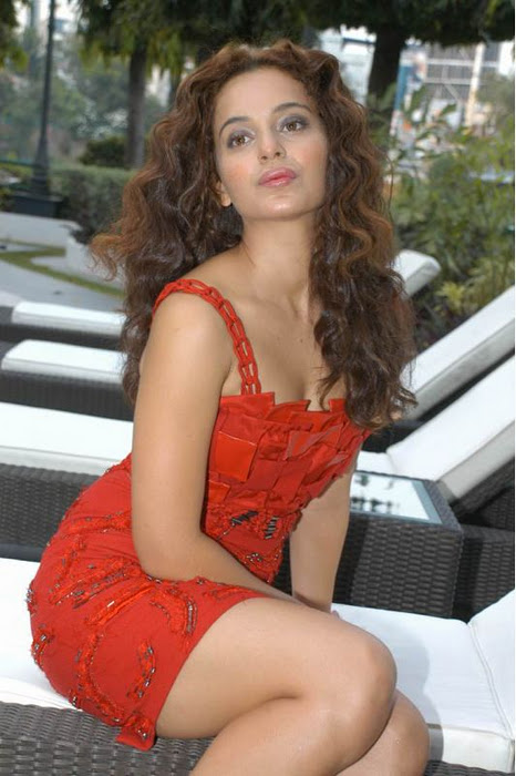 Spicy Kangana Ranaut in Orange colored Short Skirt with Black boots