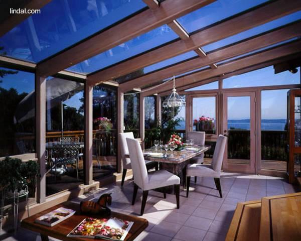 Arquitectura de casas cerramientos en cristal y madera de - Cerramientos de madera para jardin ...