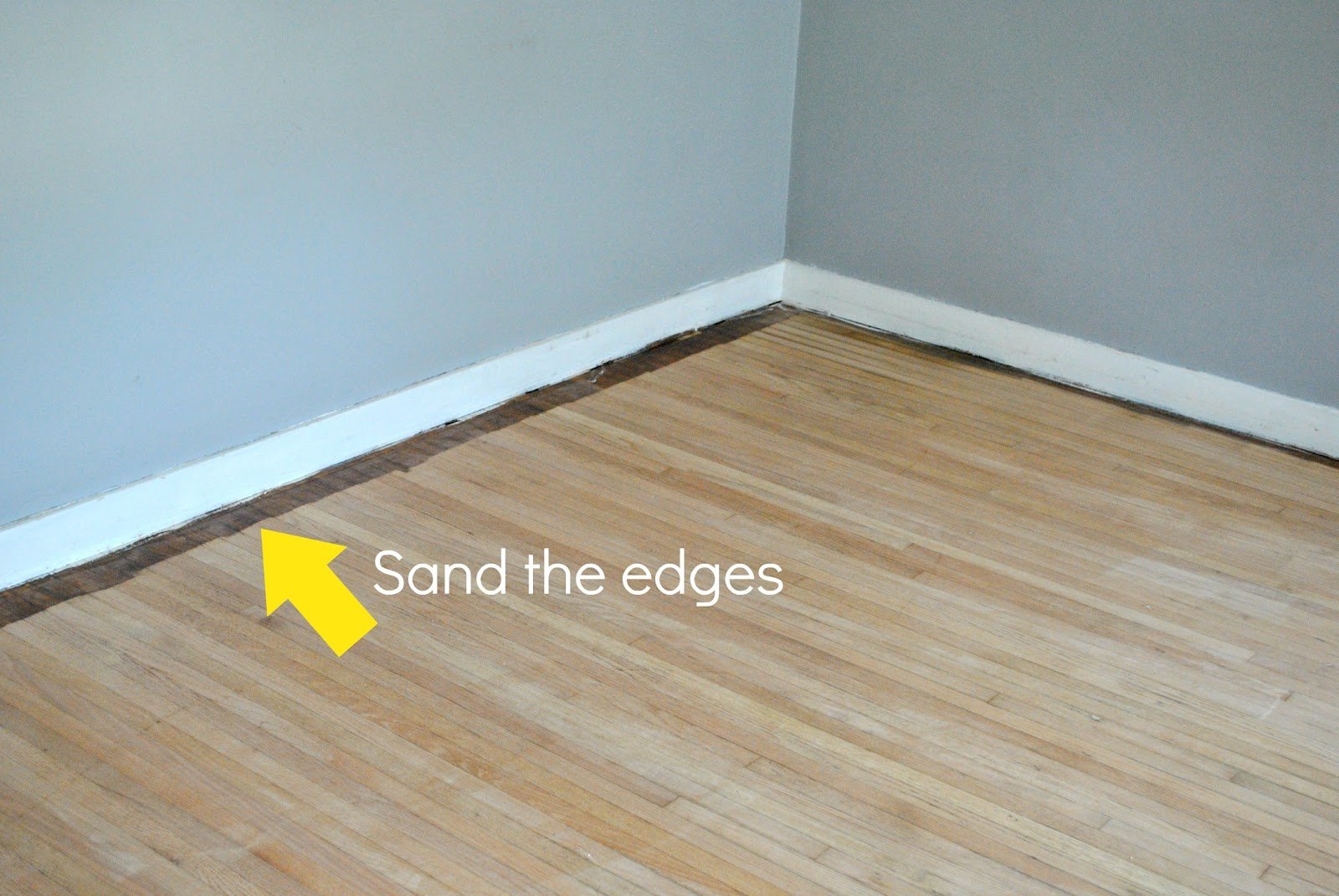 How to remove carpet and refinish wood floors part 1 classy clutter you can see there is a few inches of stain left on the outer perimeter of the flooring this is where the drum sander could not reach so you will have to solutioingenieria Choice Image