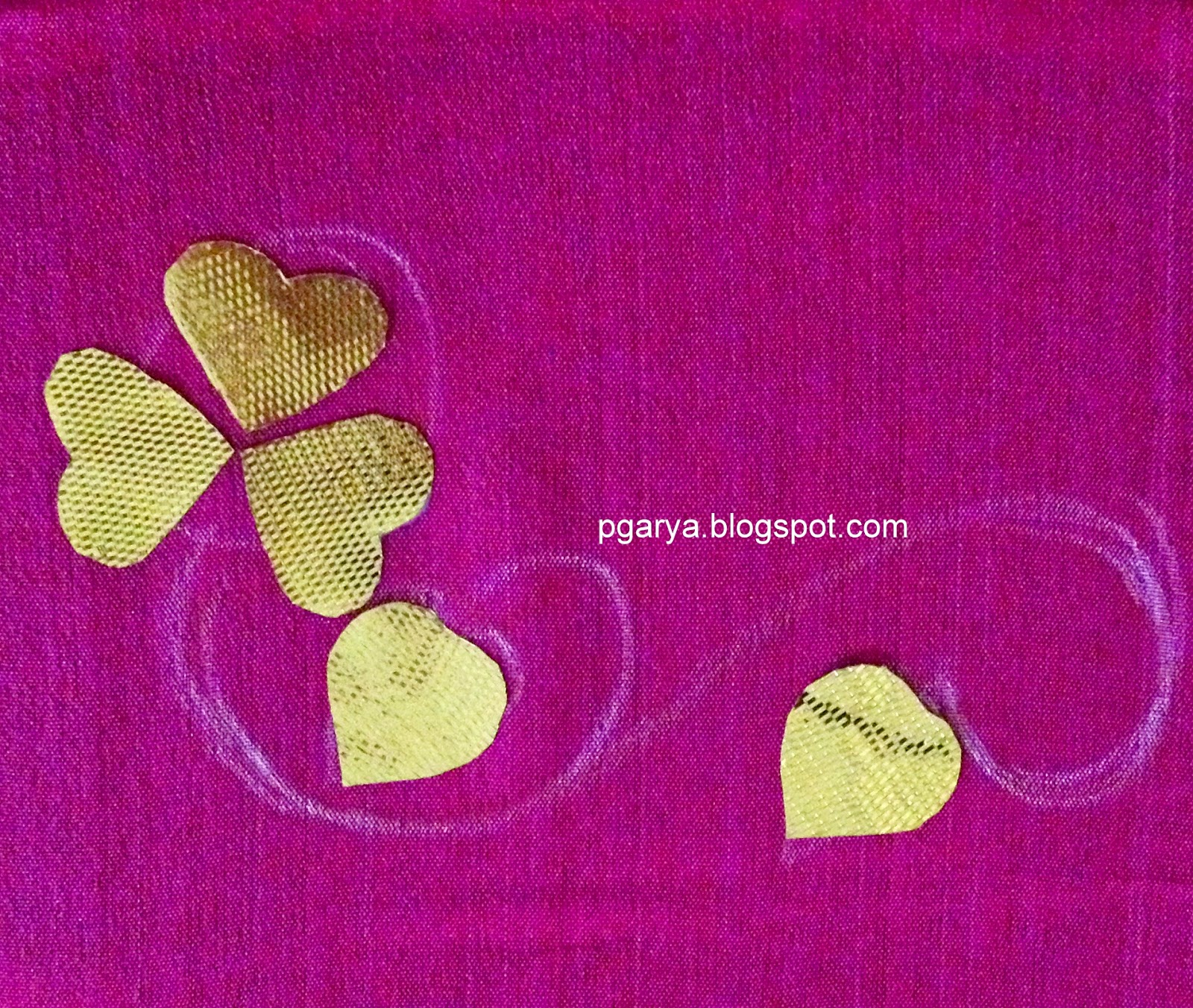 Gota with heart shape stuch on fabric with fabric glue