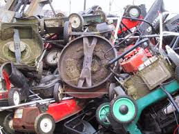 lawnmowers stacked up in the landfill