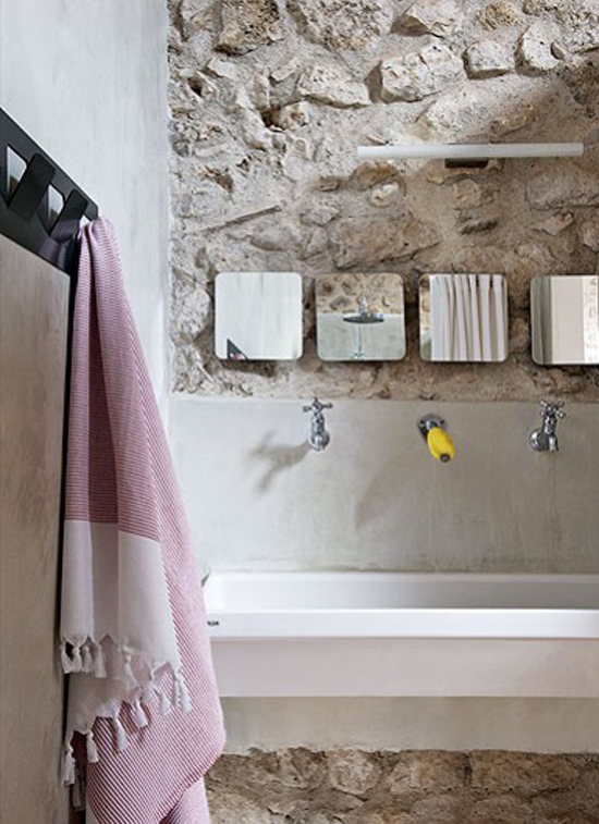 Bare stone walls in the bathroom