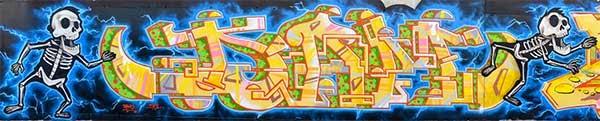 Graffiti Dam y Jolich con esqueletos