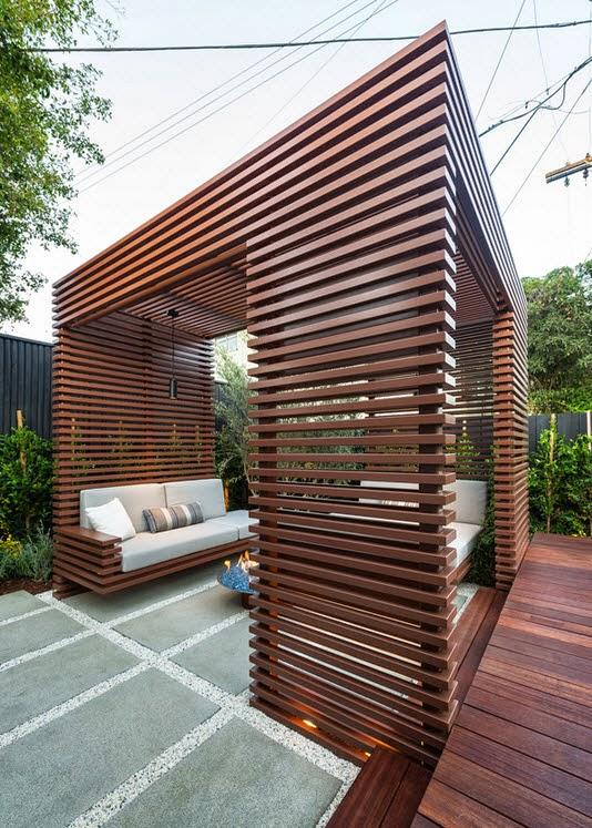 el diseo es de un cubo perfecto de madera los muebles blancos estn integrados al mdulo y parecen flotar terraza de madera