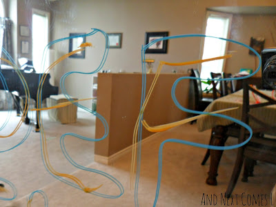 Tracing letters on mirrors with window markers from And Next Comes L