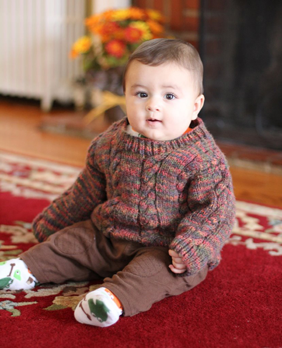 chubby adorable baby in handknit sweater