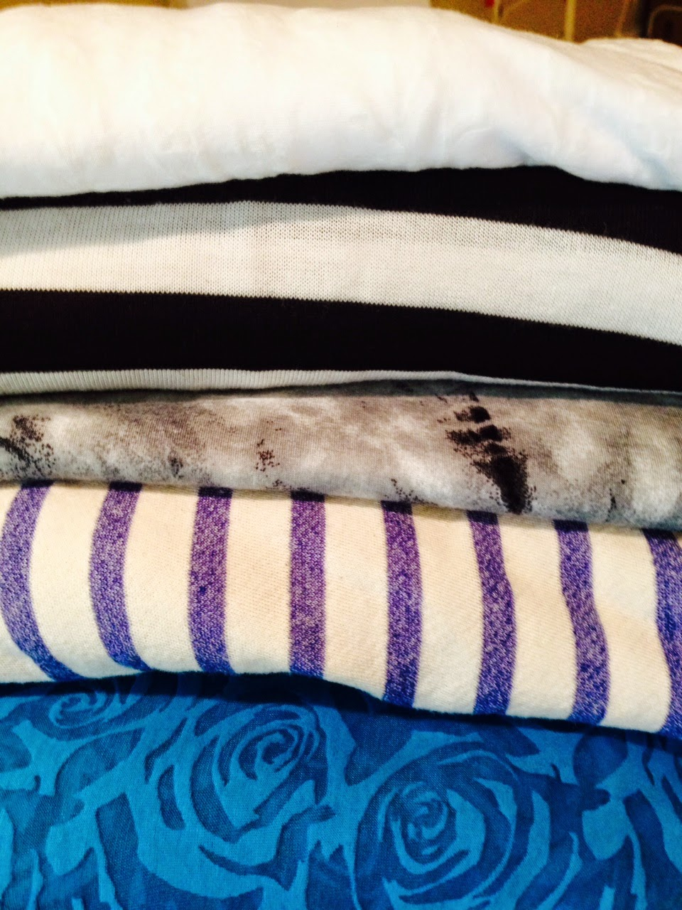 From Textiles (top to bottom): white burnout, black white striped knit, gray/black tie dye knit; terry striped knit; turquoise burnout