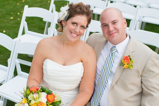 couple smiling for the camera while waiting on the ceremony to start