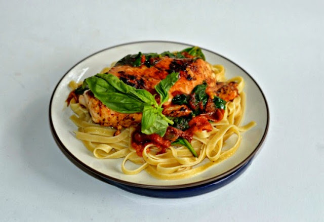 Chicken breasts sauteed with spinach, tomatoes, Italian Herb Land O' Lakes Saute Express served over top of fettuccine.