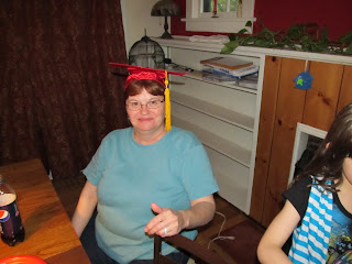 Mama, my mom, wearing Curly's cap and tassel