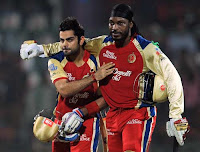 virat and chris gayle walking out of the ground like old school friends