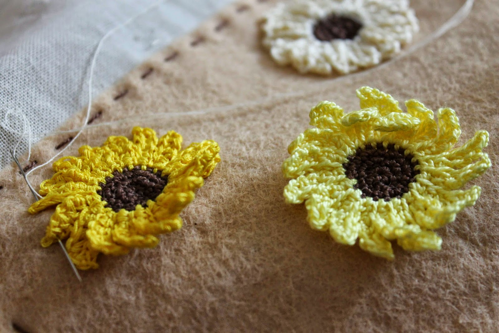 Sewing on crochet sunflowers
