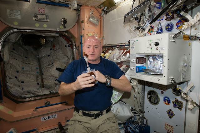 NASA astronaut Scott Kelly enjoys his first drink from the new ISSpresso machine. Credit: NASA