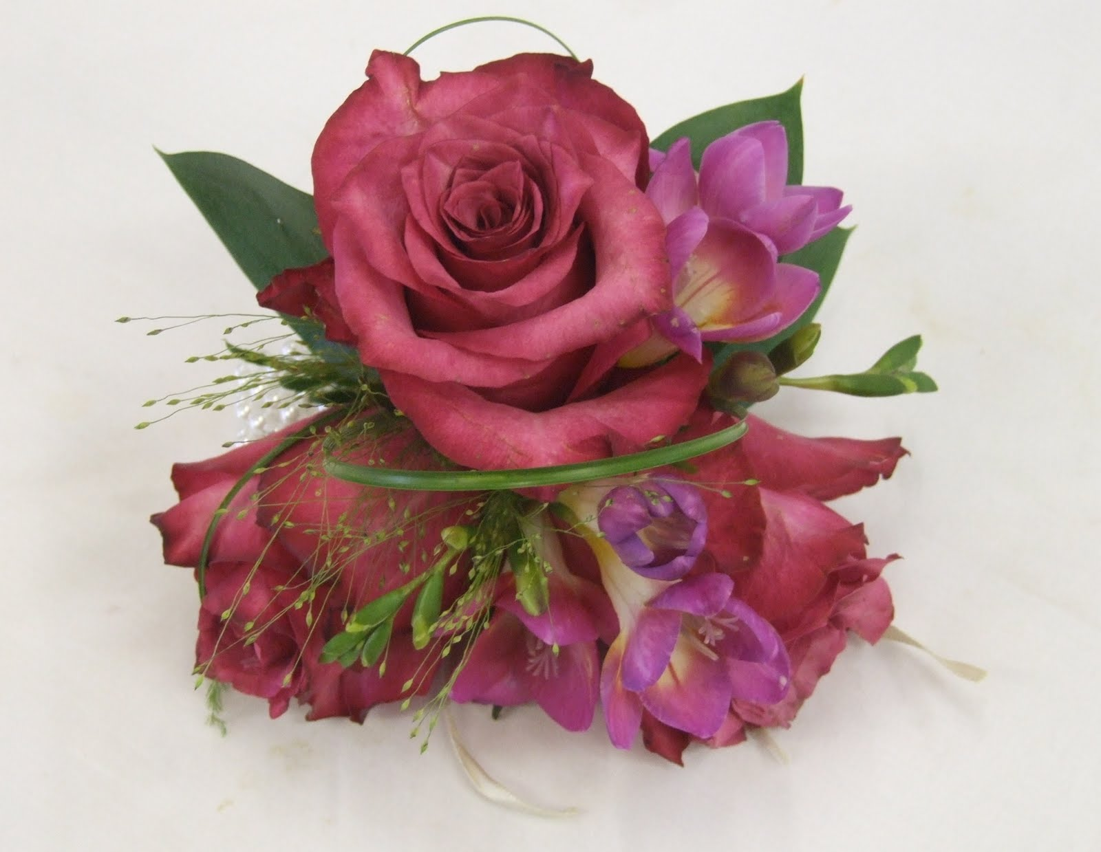 Rjs Florist Pink And White Wedding Flowers Wrist Bear The 3 Adult Bridesmaids Each Wore A Corsage Of Dark Roses Freesia With Fountain Grass Ruscus Leaves Loops