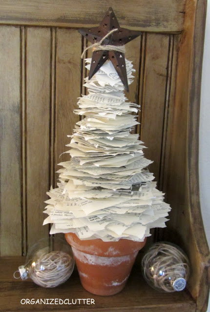 Torn Book Page Christmas Tree www.organizedclutterqueen.blogspot.com