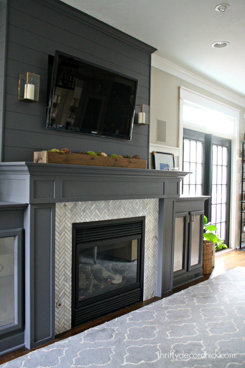 dark gray fireplace herringbone tile