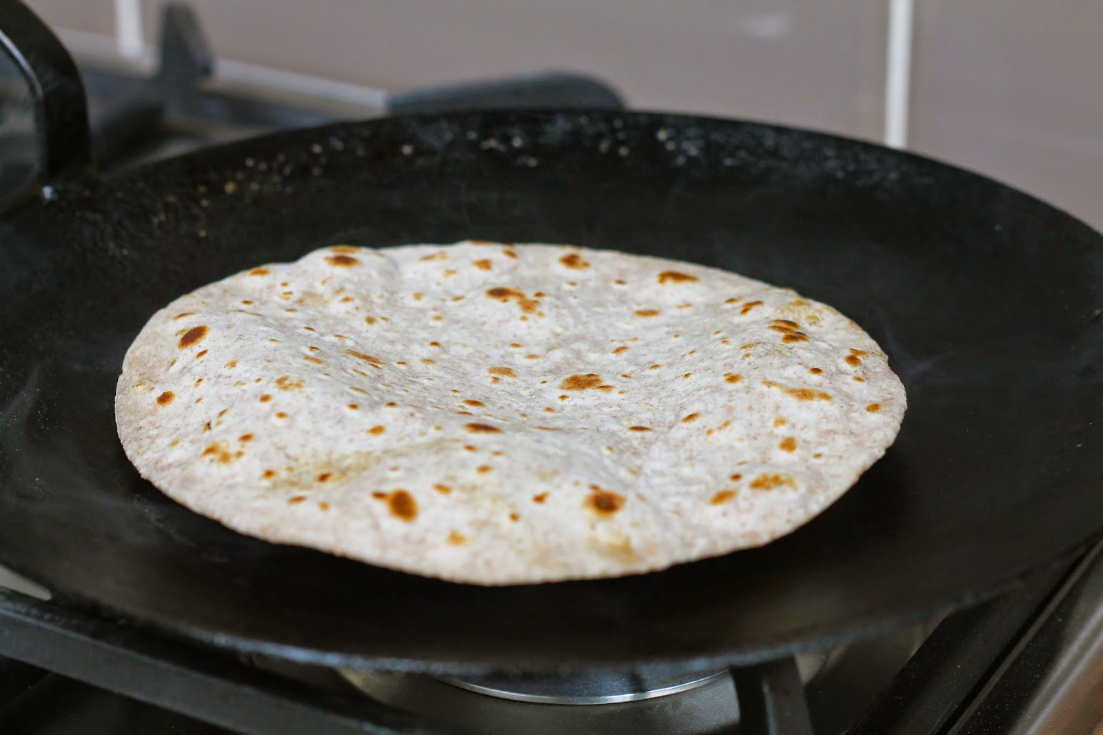 Roti cooking on the stove