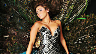 Miley cyrus with peacock bird bacground wallpaper