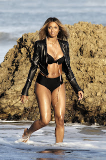 Ciara in a bikini and leather jacket in the Ocean