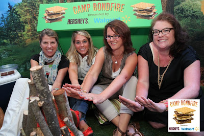 Warming our hands over the fire at the Hershey's S'mores Suite at BlogHer