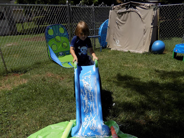 Change Up Your Outdoor Play Routine with a Shaving Cream Slide Activity #SummerFun