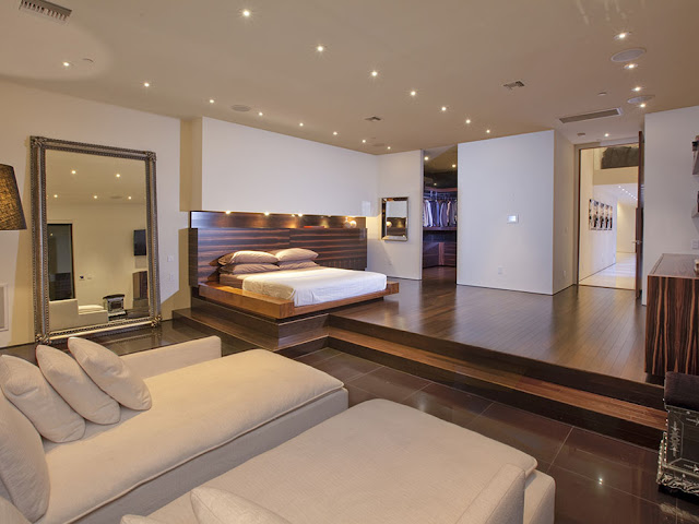 Photo of huge amazing bedroom interiors with king sized bed on the elevated surface