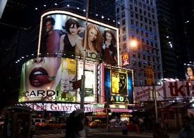 An electronic billboard advert using celebrities.