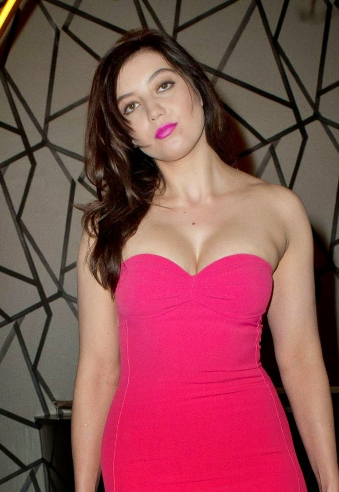 Daisy Lowe reveals cleavage in a strapless hot pink dress at the GQ Christmas Lunch in London