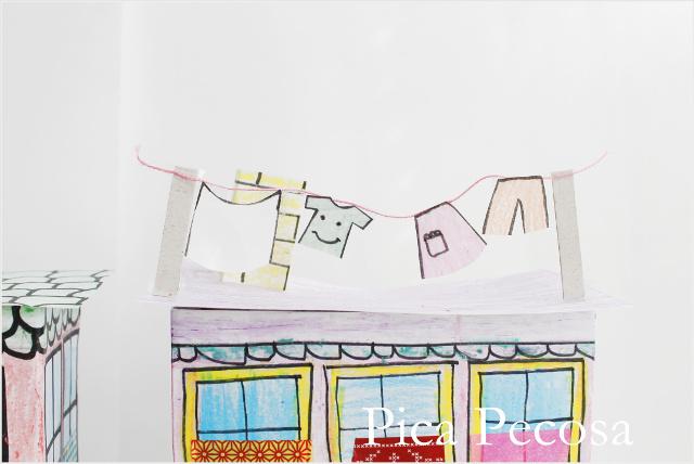 tutorial-como-hacer-casa-muñecas-con-carton-reciclado-packs-yogures-diy-tendal-con-ropa-secando