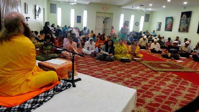 Devotees of Jagadguru Kripaluji Maharaj and Hanuman listen to bhakti yoga lecture and kirtan in New York