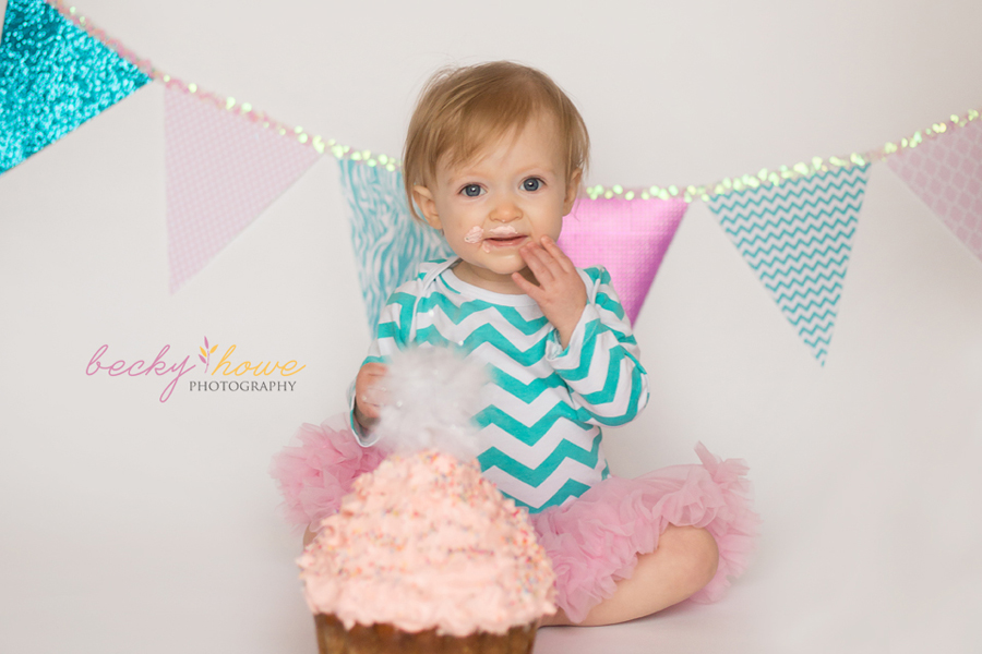 cake smash photography one year old pink green
