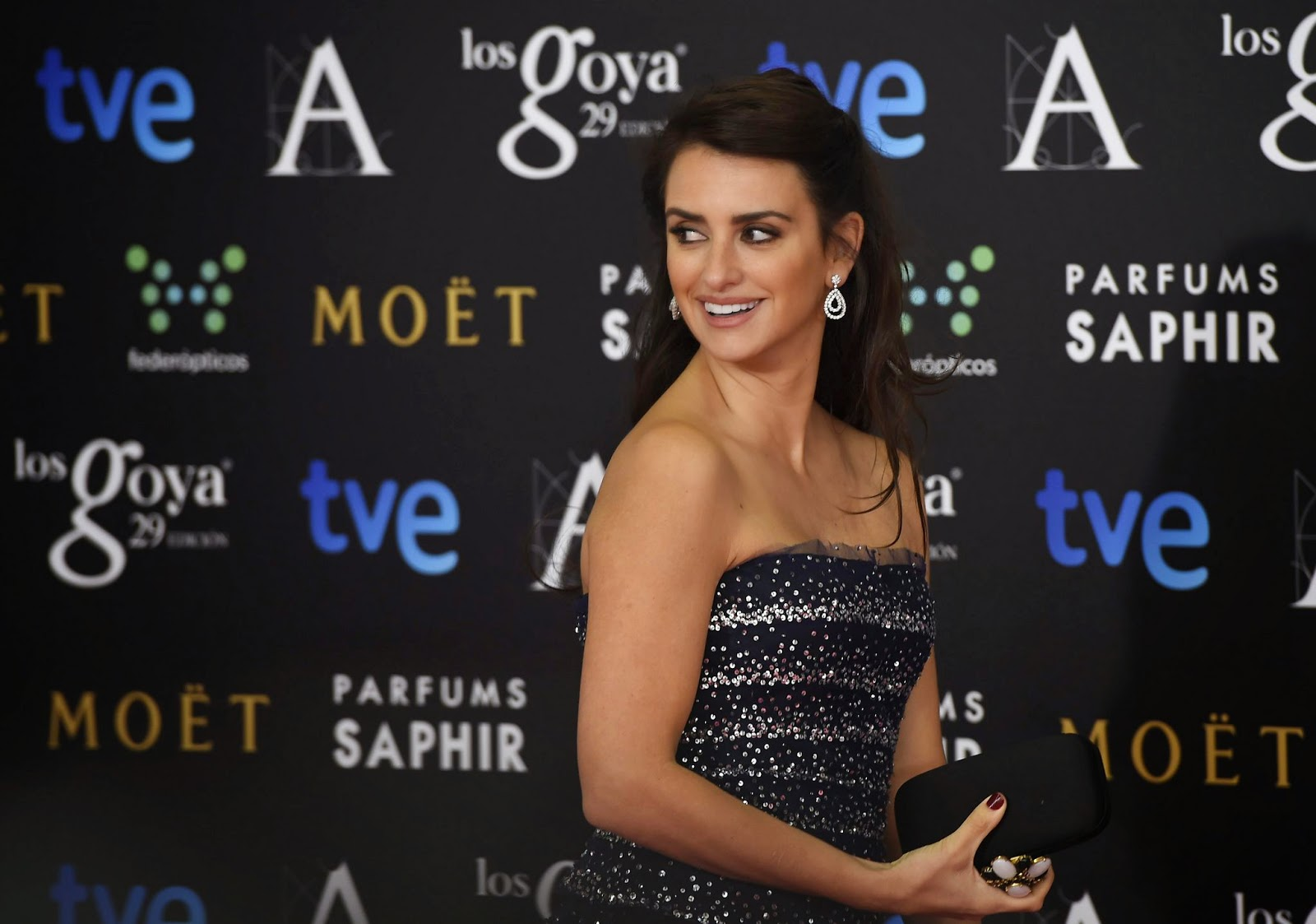 Penelope Cruz dazzles in a strapless navy blue gown at the 2015 Goya Film Awards in Madrid