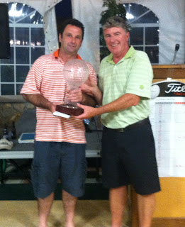 Brian Kennedy, Chair of the ICC Golf Tournament awards winner's trophy to Steve Mitchell and his foursome.