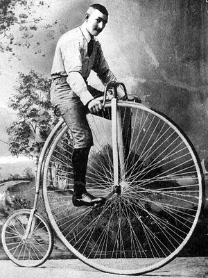 Man on Victorian era bicycle