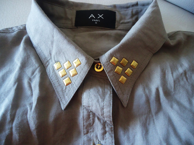 details golden studs in shirt collar