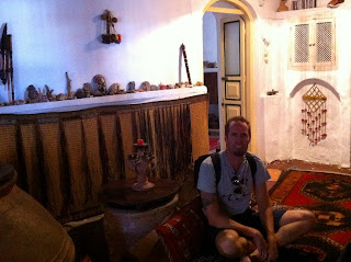 Sitting on the floor of the Taksiyarhis Pension in Ayvalik, Turkey.