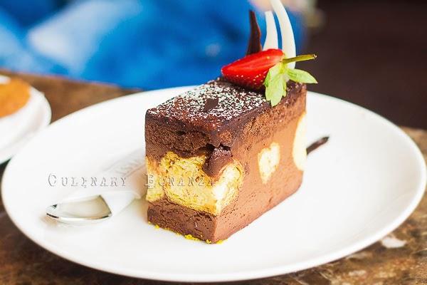 Chocolate Pearl - chocolate mousse, vanilla profiterole sandwiched between chocolate sponge cake