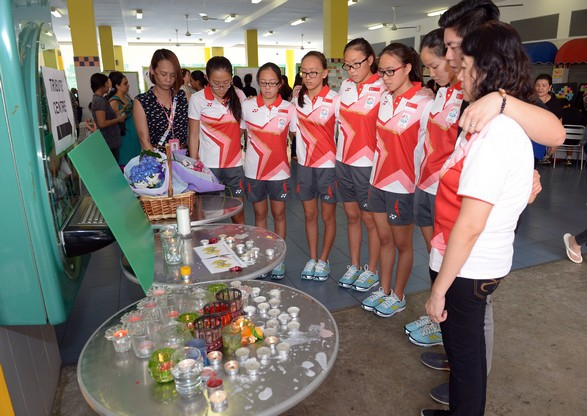 Synchronised swimming team paying their respects to the perished at Tanjong Katong Pri Sch