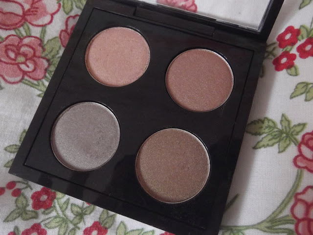 An image of a MAC Eyeshadow Quad in Sable, Woodwinked, Satin Taupe and All That Glitters
