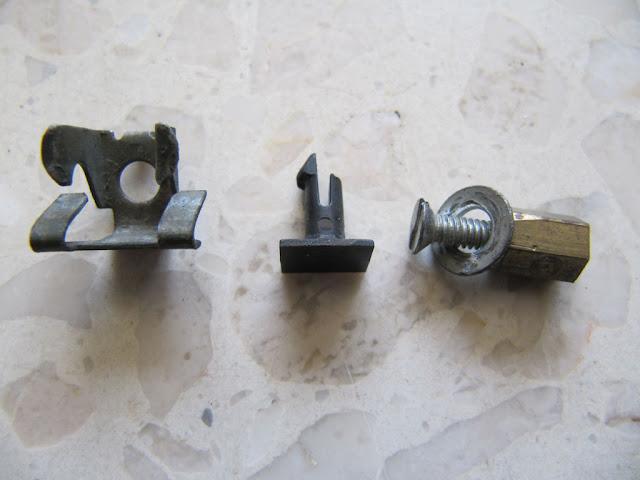 pasador, pieza rota y tornillo de sustitución
