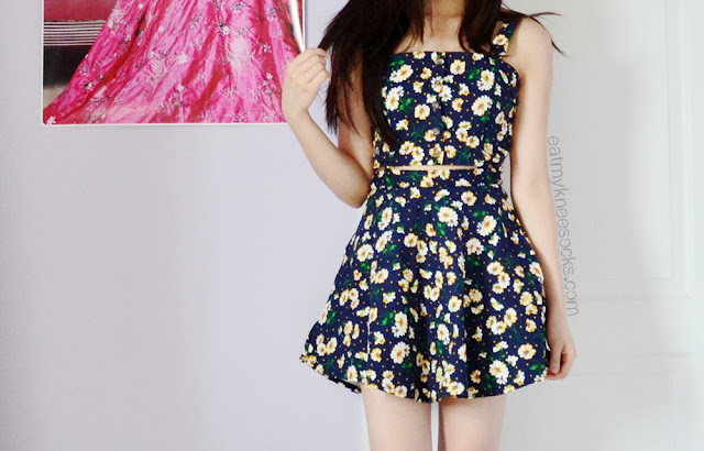 For a cute, ulzzang-inspired summer outfit, try flirty floral dresses, like this cutout suspender skater dress from SheIn/SheInside.