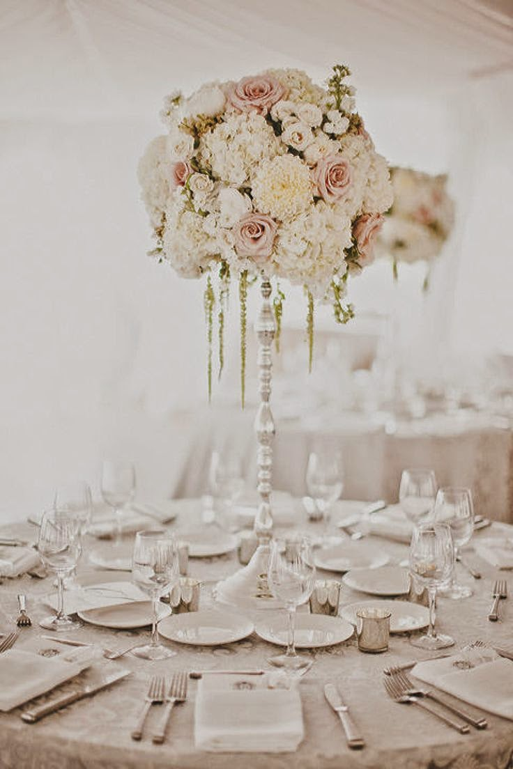 Luxury at your wedding: tall floral arrangements