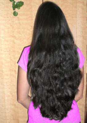 Beautiful Malayali aunt with curly long hair.