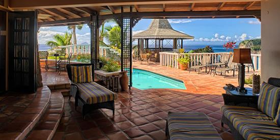The pool, gazebo and sea view of this luxury Montserrat property