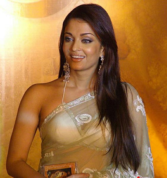 Spicy Celebrity Pics: Aishwarya Rai spicy in saree photo gallery