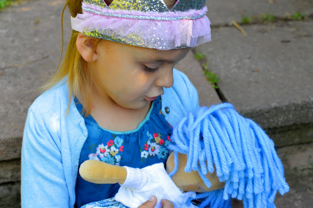 Girl in issa crown with La Nina Doll