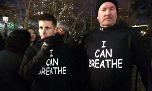 "Photo of white men wearing ""I Can Breathe"" shirts"